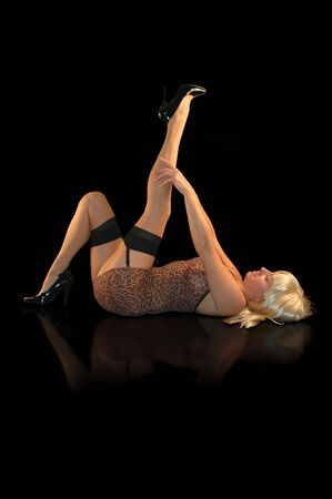 pretty blond woman pulling her stockings up tight. Stock Photo - 2383858