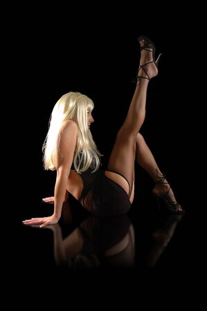 blonde woman wearing cabaret lingerie jutting leg into the air.