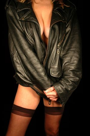 female clad in leather jacket and thigh high hose.