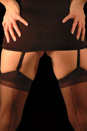 close up reaer view of woman wearing stockings and garters with black mini skirt. Stock Photo - 2564220