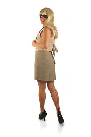pretty blond wearing stockings, high heels, and skirt.