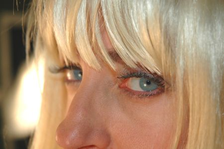 close up of blond female model with blue eyes. Stock Photo
