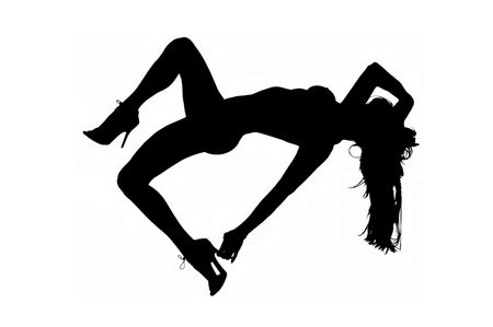 silhouette of sexy female dancer with long hair and high heels. Stock Photo