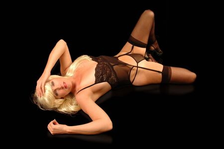 sexy blond woman in black lingerie and high heels.