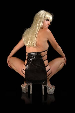 blond female dancer in black mini skirt and high heel platform shoes.
