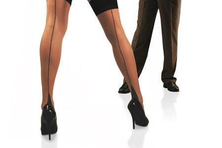 womans legs in thigh high stockings in front man in slacks. Stock Photo