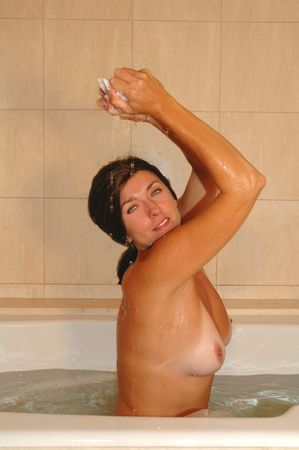 pretty woman relaxing in warm bath tub.