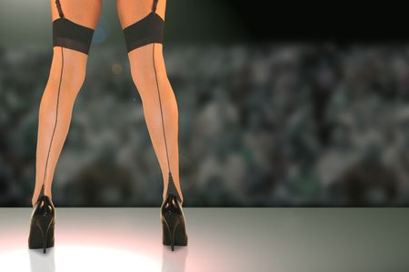 female dancers legs in stockings and high heels.