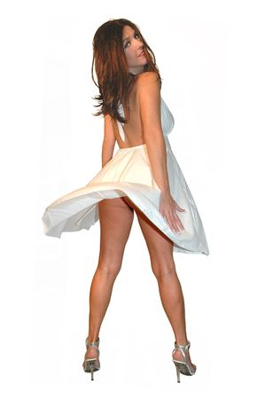 pretty brunette woman with white dress blowing up.