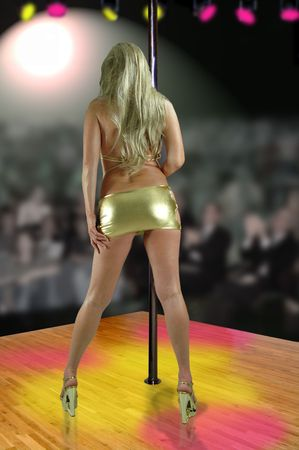 female stripper wearing gold dress dancing in gentlemans club. Stock Photo - 5054997