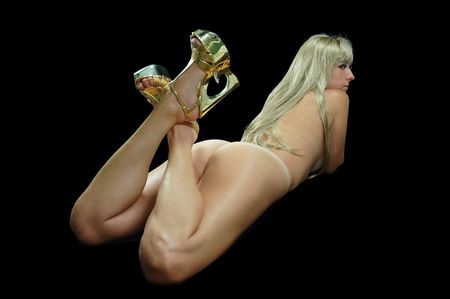 pretty nude blond woman wearing gold high heeled shoes. Stock Photo - 5266224