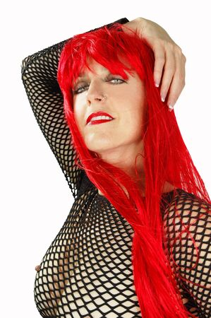 sultry redhead wearing see through mesh fishnet top.