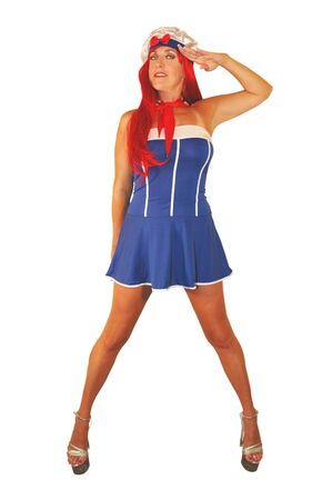 pretty red head woman saluting in sailor outfit. Stock Photo