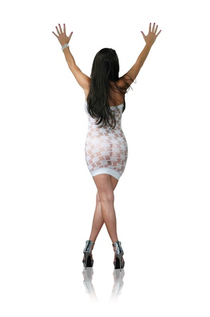 shapely brunette woman wearing sheer white dress and high heels.