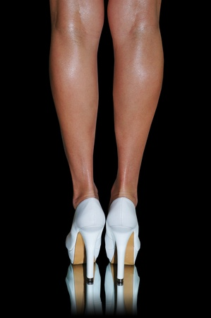 female legs and white high heeled pumps. Stock Photo