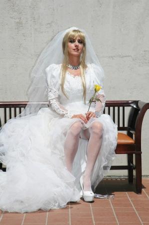 pretty new bride posing holding yellow rose.
