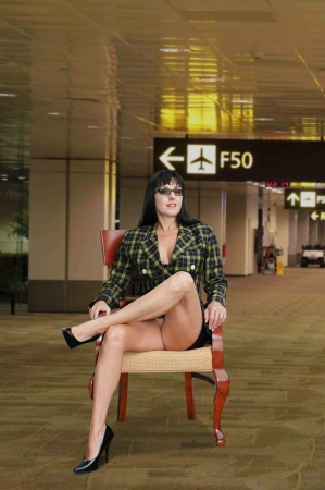 sexy business woman sitting in airport.