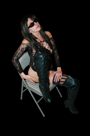 brunette woman wearing lace dress and thigh high black boots.