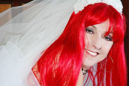 pretty redhead bride posing for photographer. Stock Photo