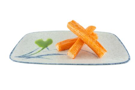 Group crab stick with wasabi sause on plate. isolated on white background with clipping path