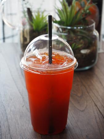 Local Iced Thai Lemon Tea With Terrarium Background