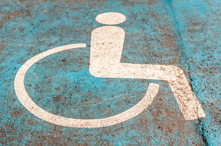 handicapped: the symbol handicapped on a parking space