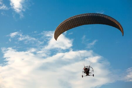 Parachute flying in blue sky