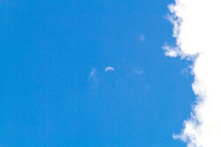 Beautiful nature Moon in the clear sky in the afternoon on day soft focus Imagens