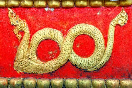 Vintage Laos stye Stucco of Na ga at Wat tat luang vientian Laos Stockfoto