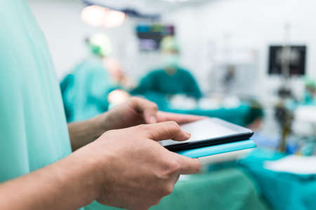 Surgeon using digital tablet