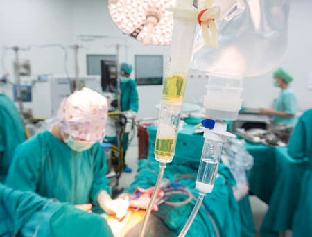 Anesthesiologist change rate iv during the operation photo