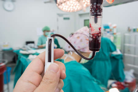 anesthesiologist: Anesthesiologist change rate iv during the operation Stock Photo