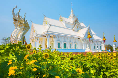 White church with Thai temple architecture