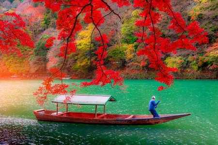Boatman punting the boat at Katsura River 写真素材