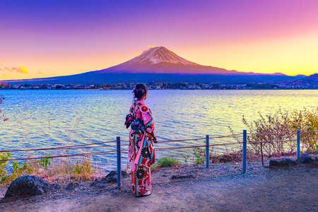 Asian woman wearing japanese traditional kimono at Fuji mountain. Sunset at Kawaguchiko lake in Kyoto, Japan