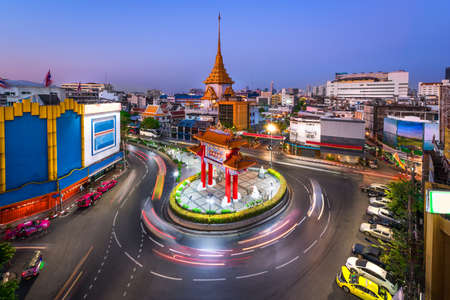 Traffic passes through Chinatown at Odeon Roundabout. The roundabout marks one end of Chinatown in Bangkok, Thailand
