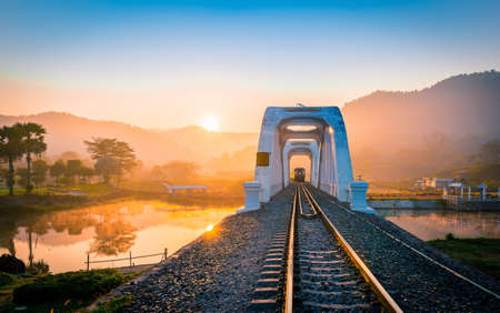 White Bridge Railway(train white bridge) In the history of Mae Tha, Lamphun in the mist in the winter.Take a train from Lampang to Chiang mai