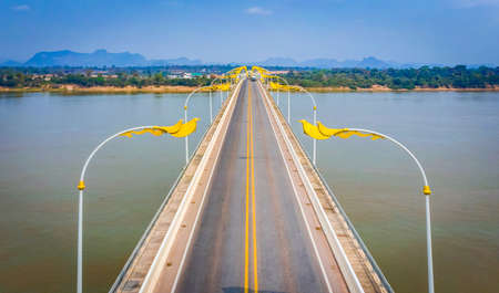 Bird eye view 3rd Thai-Lao Friendship Bridge ,The Third Thai–Lao Friendship Bridge over the Mekong is a bridge that connects Nakhon Phanom Province in Thailand with Thakhek, Khammouane in Laos Banco de Imagens