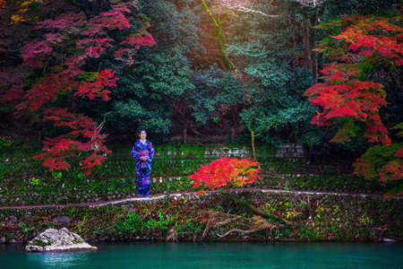 Asian woman wearing japanese traditional kimono in autumn 版權商用圖片