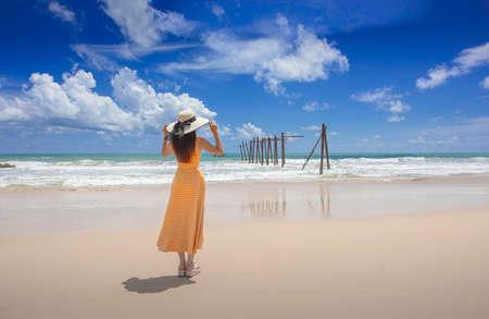 Asian woman standing by the beach near Old bridge Khao pilai natai beach Phangnga ,Thailand Zdjęcie Seryjne