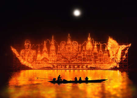raditional fire boat floating in Mekong river at night with design the light lamp about Phrathat Phanom Pagoda, king of Thailand, Fire-boat festival, Nakhon Phanom province, Thailand