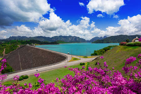 Beautiful blue sky with flower and clear water , Ratchaprapa Dam or Guilin of Thailand the famous of Nation Park in Suratthani, Thailand