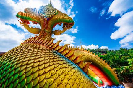 Big gold naga statue in Wat tham pha daen temple, the famous place of Sakon Nakhon Province, Thailand. Stock Photo