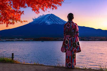 Asian woman wearing japanese traditional kimono at Fuji mountain. Sunset at Kawaguchiko lake in Japan