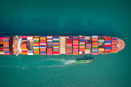 Container ship in export and import business and logistics. Aerial view Foto de archivo