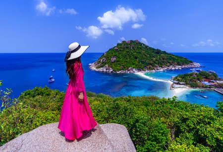 Asian woman standing on viewpoint at Koh Nangyuan island near Koh Tao island, Surat Thani province ,Thailand