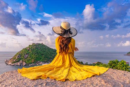Asian female tourist sitting at the viewpoint on  Koh Nang Yuan island, Thailand