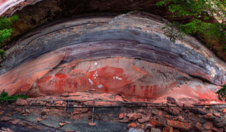 Panorama of Prehistoric paintings on a cliff in the northeast of the country in Ubon Ratchathani ,Thailand. Sandstone texture and ancient painting in Pha Taem National Park Imagens