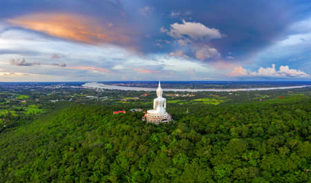 Top view Aerial photo from flying drone. Big Buddha Wat Phu Manorom Mukdahan province, Thailand.