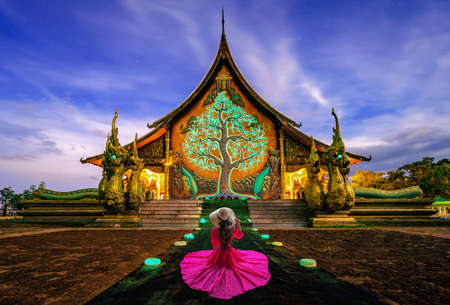 Thai woman visit Amazing glow Temple at  Sirindhorn wararam phu prao temple or Wat phu prao at Sirindhorn District in Ubon Ratchathani, Thailand Stok Fotoğraf